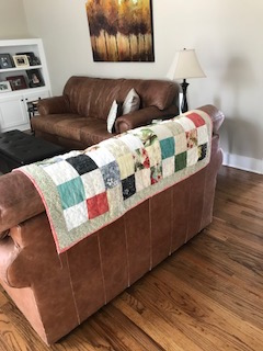 Tropical quilt on couch